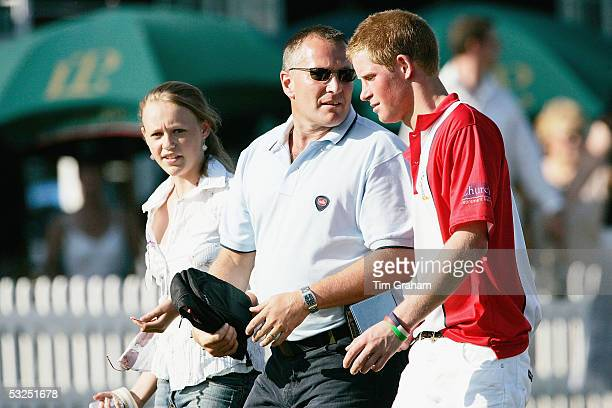 Prince Harry walks with a personal police body guard and a friend to a polo match at Cirencester Park where he will play for the Emlor team against...