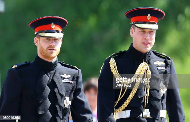 Prince Harry walks with his best man, Prince William, Duke of Cambridge as they arrive at St George's Chapel at Windsor Castle before the wedding of...