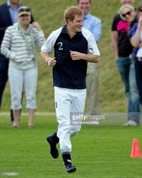 Prince Harry warms up prior to playing in the Bernard Weatherill Cup charity polo match at Beaufort Polo Club on June 19 2011 in Tetbury England