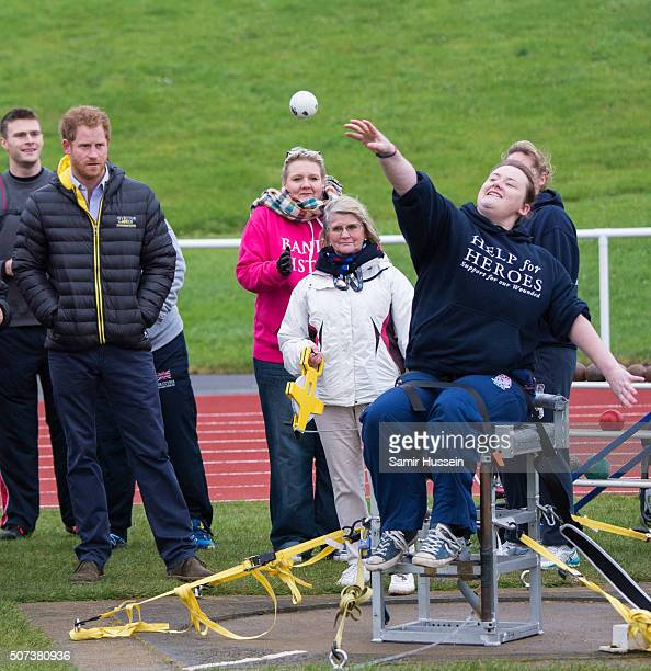 Prince Harry watches a competitor as he attends the UK team trials for the Invictus Games Orlando 2016 at University of Bath on January 29 2016 in...
