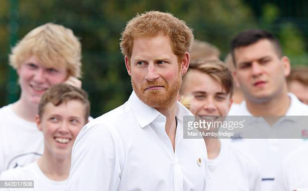 Prince Harry watches a demonstration as he attends an RFUbacked community rugby programme in Alexandra Park on June 21 2016 in Stockport England
