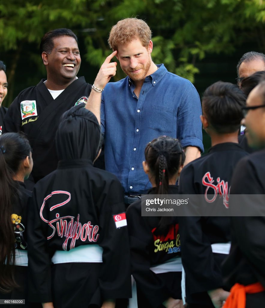 Prince Harry watches a martial arts demonstration at Jamiyah Singapore on the first day of a two day visit to Singapore on June 4, 2017 in Singapore.