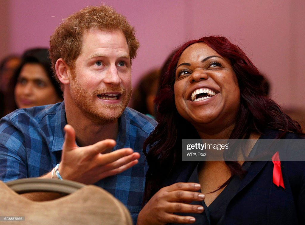 Prince Harry watches a rehearsal by the 'Joyful Noise' choir, a creation of NAZ, a sexual health charity for minority communities, with CEO Marion Wadibia at The Hurlingham club on November 15, 2016 in London, England.