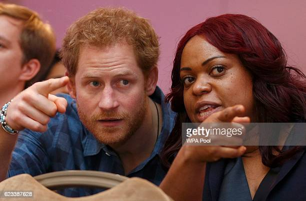Prince Harry watches a rehearsal by the Joyful Noise choir a creation of NAZ a sexual health charity for minority communities with CEO Marion Wadibia...