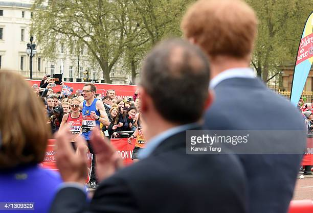 Prince Harry watches Paula Radcliffe complete her last marathon at the London Marathon on April 26 2015 in London England