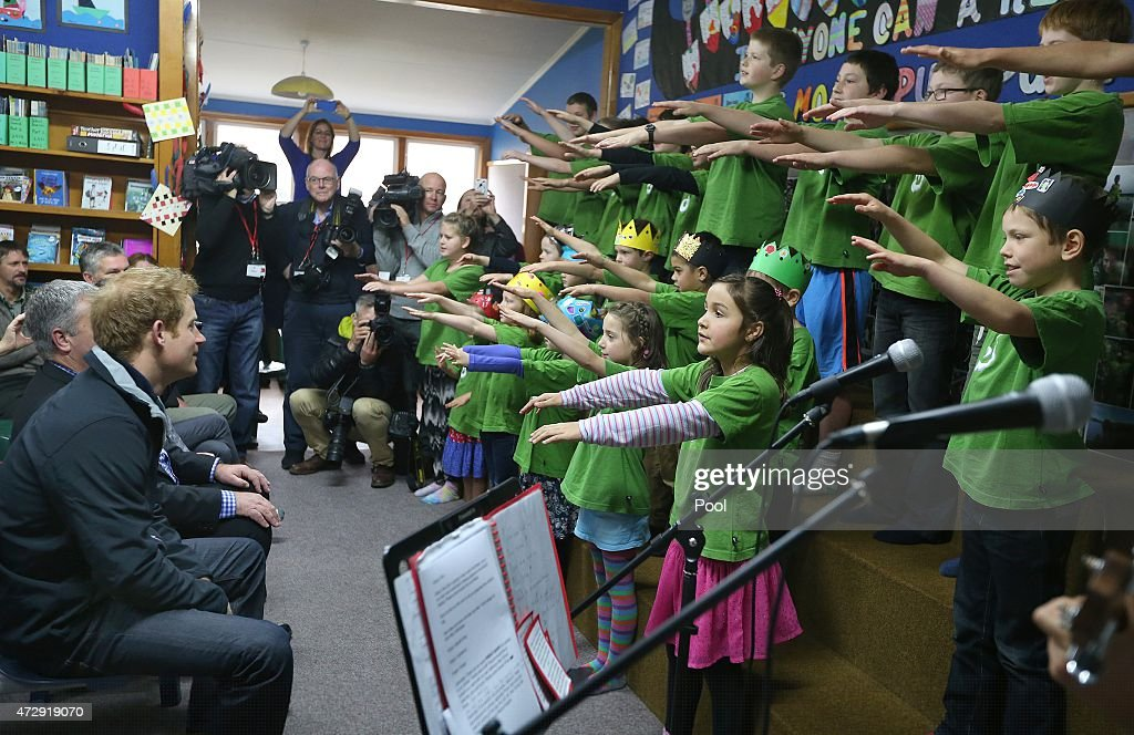 Prince Harry watches pupils perform a Maori song for him during his visit to Halfmoon Bay School in Oban as he leaves on May 11, 2015 in Stewart Island, New Zealand. Prince Harry is in New Zealand from May 9 through to May 16 attending events in Wellington, Invercargill, Stewart Island, Christchurch, Linton, Whanganui and Auckland.