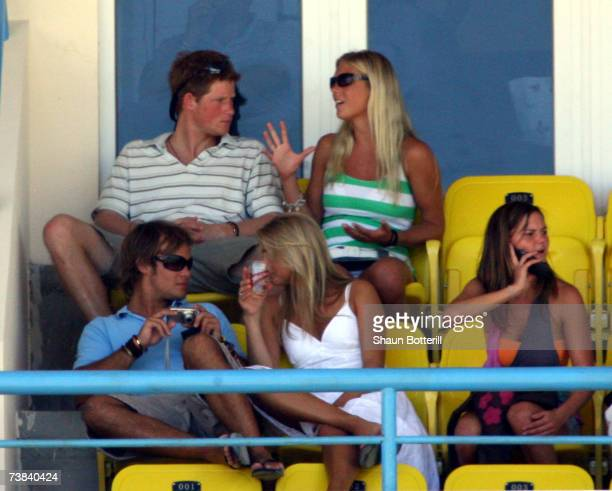 Prince Harry watches the cricket with his girlfriend Chelsy Davy during the ICC Cricket World Cup 2007 Super Eight match between England and...