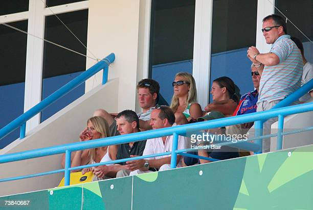 Prince Harry watches the cricket with his girlfriend Chelsy Davy during the ICC Cricket World Cup Super Eights match between Australia and England at...