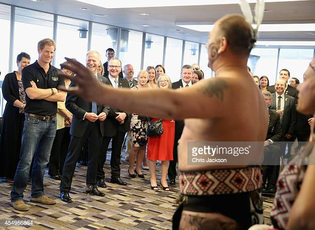 Prince Harry watches traditional dancing with New Zealand Hight Commissioner Lockwood Smith at a New Zealand Invictus Team reception at New Zealand...
