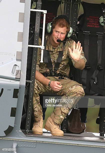 Prince Harry waves from an NH70 helicopter as he leaves Military Base during a visit on May 13 2015 in Palmerston North New Zealand Prince Harry is...