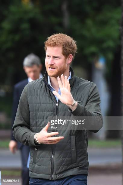 Prince Harry waves to a small group of onlookers as he arrives for a venue tour of the Sydney International Aquatic Centre on June 8 2017 in Sydney...