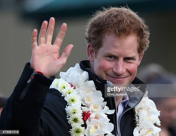 Prince Harry waves to pupils at Southern Cross School Campus on May 15 2015 in Auckland New Zealand Prince Harry is in New Zealand from May 9 through...