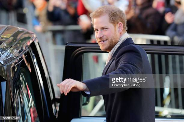 Prince Harry waves to the crowd as he departs Nottingham Contemporary alongside Meghan Markle on December 1 2017 in Nottingham England Prince Harry...