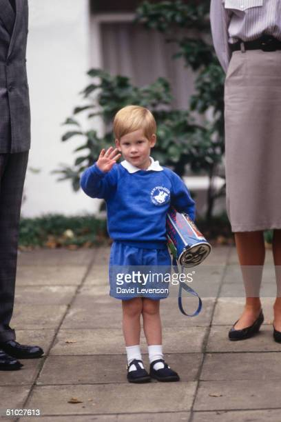 Prince Harry waving to photographers as he arrived for his first day at Mrs. Mynor's nursery school on September 16, 1987 in Notting Hill, London.