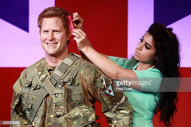 Prince Harry waxwork A new wax figure of Prince Harry is unveiled at Madame Tussauds on September 9 2014 in London England