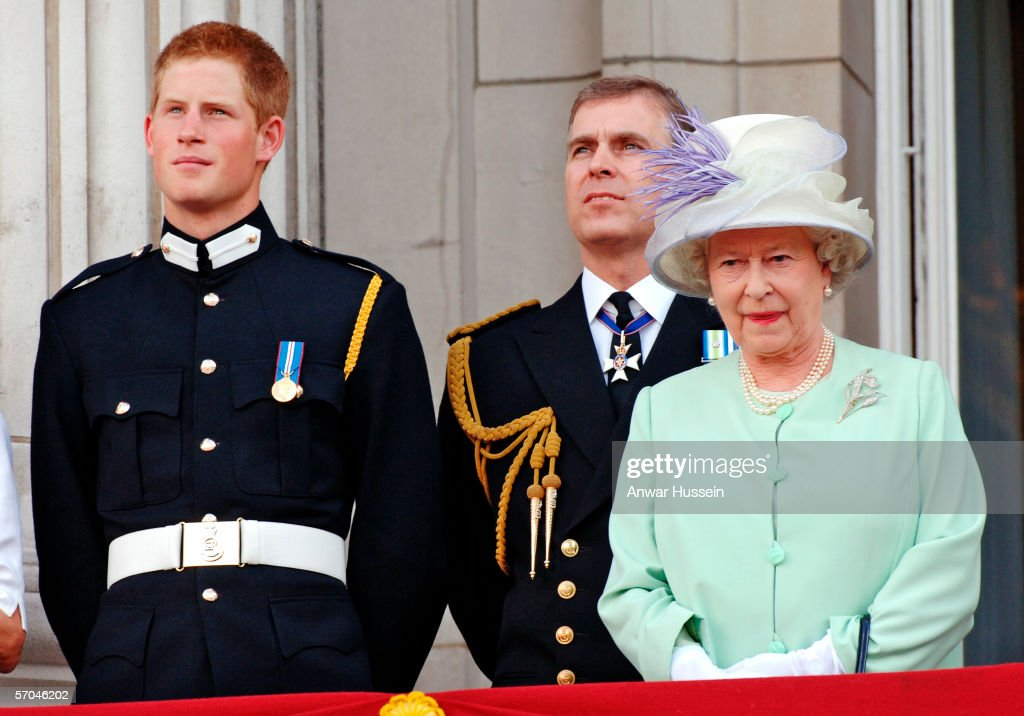 Prince Harry wearing his Sandhurst army uniform, Prince Andrew the Duke of York and HM Queen Elizabeth ll watch the flypast over The Mall of British and US World War II aircraft from the Buckingham Palace balcony on National Commemoration Day July 10, 2005 in London. Poppies were dropped from the Lancaster Bomber of the Battle Of Britain Memorial Flight as part of the flypast.