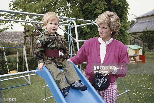 Prince Harry wearing the uniform of the Parachute Regiment of the British Army in the garden of Highgrove House in Gloucestershire 18th July 1986 He...