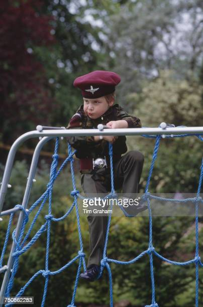 Prince Harry wearing the uniform of the Parachute Regiment of the British Army in the garden of Highgrove House in Gloucestershire 18th July 1986