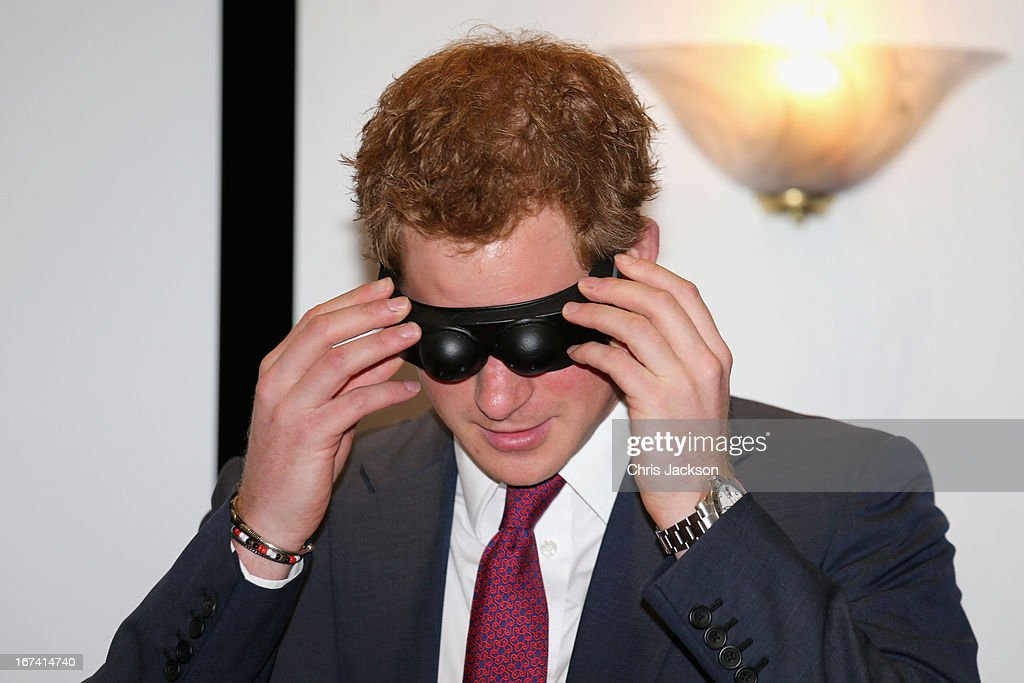 Prince Harry wears a pair of goggles to experience what it is like to have a brain injury during a visit to Headway, the brain injury association at Bradbury House during an official visit to Nottingham on April 25, 2013 in Nottingham, England.