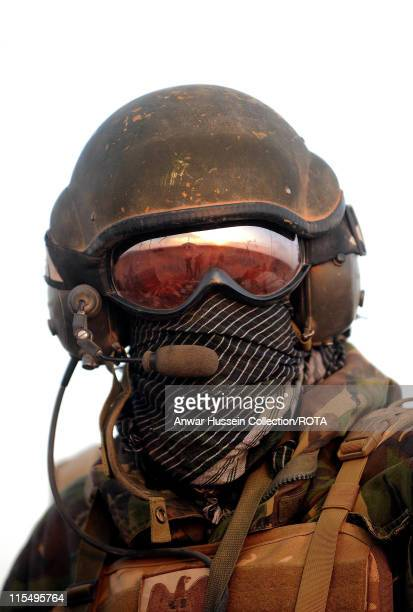 Prince Harry wears a scarf and goggles to protect himself from the dust in the desert on February 19, 2008 in Helmand Province, Afghanistan.