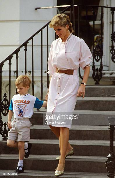 Prince Harry wears a Thomas the Tank Engine teeshirt when he leaves nursery school with his mother Diana Princess of Wales in June 1989 in London...
