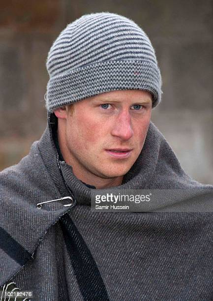 Prince Harry wears a warm hat and blanket when he visits the Herd Boy School on June 17 2010 in Semonkong Lesotho The Princes are on a joint trip to...