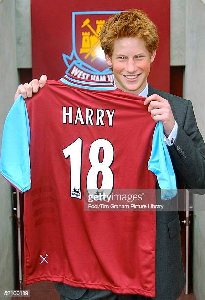 Prince Harry With A Football Shirt He Was Presented With During A Visit To The Youth Squad Members At West Ham United's Upton Park Football Ground...