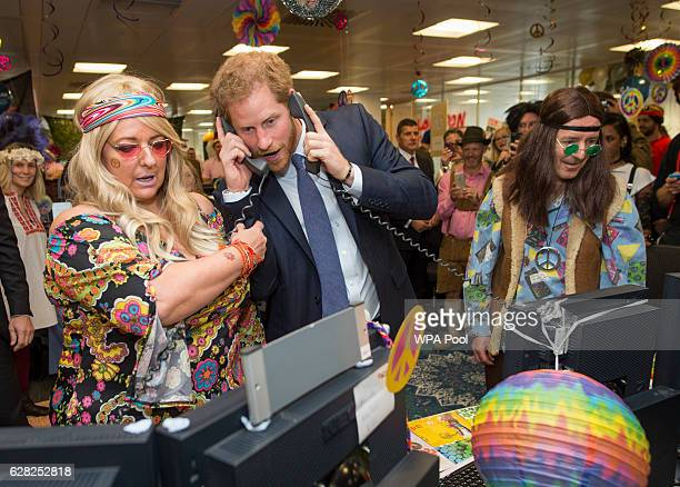 Prince Harry with Amanda Hartnell and Dermot Doherty on the European Repo Desk during an ICAP Charity Trading Day in support of Sentebale on December...