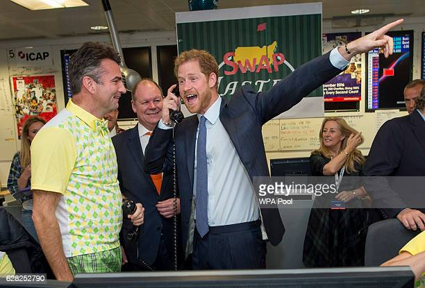 Prince Harry with Edward Bird on the Interest Rate Swaps Desk during an ICAP Charity Trading Day in support of Sentebale on December 7 2016 in London...