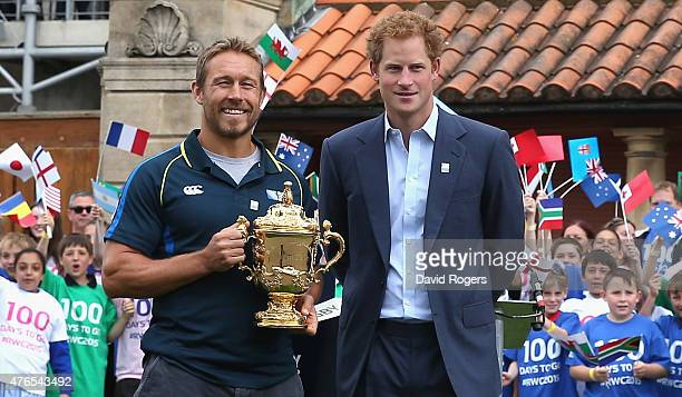Prince Harry with England World Cup winner Jonny Wilkinson pose with the Webb Ellis Trophy at the Launch of the Rugby World Cup Trophy Tour at...
