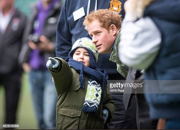 Prince Harry with Harrison Hogg while watching a training session for RFU Injured Players Foundation runners taking part in this year's London...
