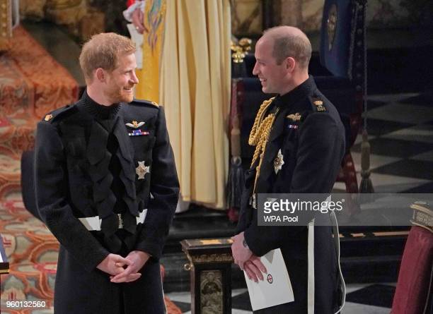 Prince Harry with his Best Man the Duke of Cambridge wait for the start of his wedding ceremony to Meghan Markle at St George's Chapel at Windsor...