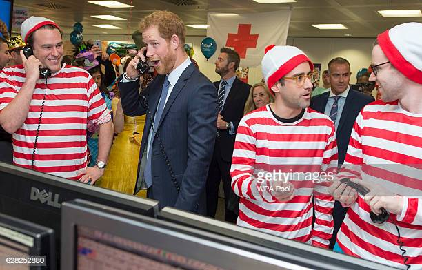 Prince Harry with Jack O'Brien and Phil McMahon on the Aus/Nz Forwards Desk during an ICAP Charity Trading Day in support of Sentebale on December 7...
