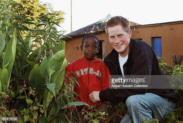 Prince Harry, with old friend Mutsu Potsane, inspects the Peach Tree that they planted in the grounds of the Mants'ase childrens home, in March 2004...