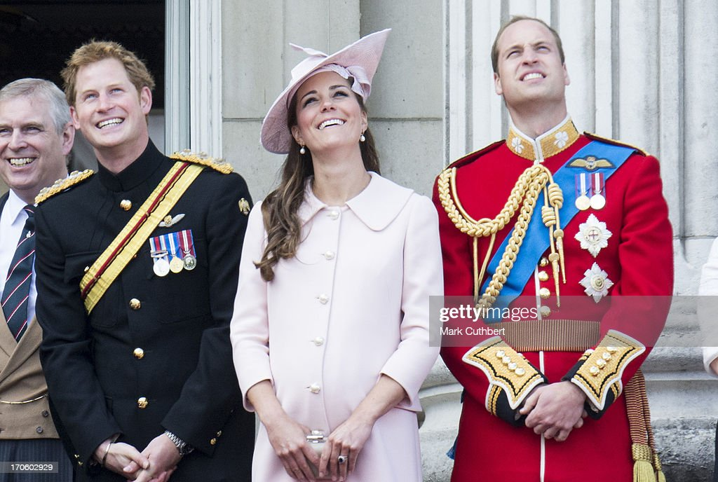 Prince Harry with Prince William, Duke of Cambridge and Catherine, Duchess of Cambridge during the annual Trooping The Colour ceremony at Buckingham Palace on June 15, 2013 in London, England.