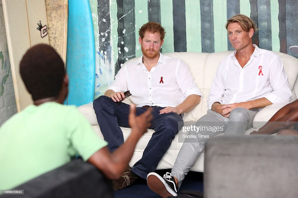 Prince Harry with the founder of Surfers Not Street Children, Tom Hewitt on December 1, 2015 at in Durban, South Africa. Earlier, the British Royal visited the Kings Park Stadium and played tag rugby with children against a team led by former Springbok captain John Smit.