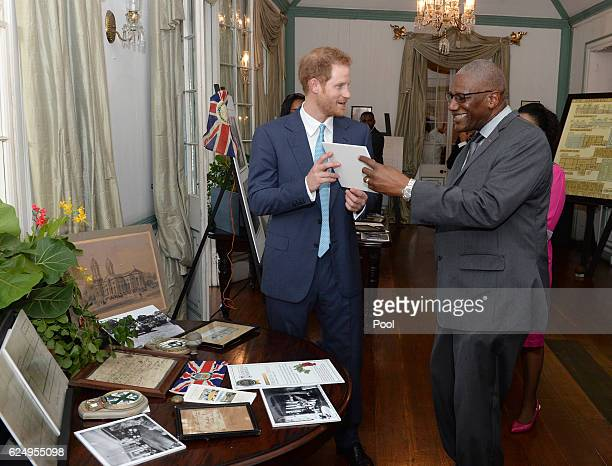 Prince Harry with the Governor General Sir Rodney Williams as he attends attends a Charity showcase at Government House on the second day of an...