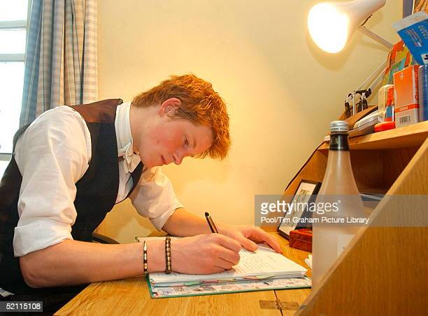 Prince Harry Writing At His Desk In His Room At Eton College Boarding School Within Limits Students Are Allowed To Decorate Their Room Themselves He...