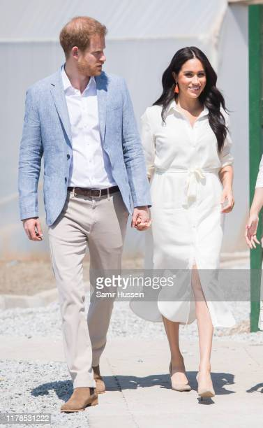 Prince Harrye Duke of Sussex and Meghan Duchess of Sussex visit the Tembisa Township to learn about Youth Employment Services on October 02 2019 in...