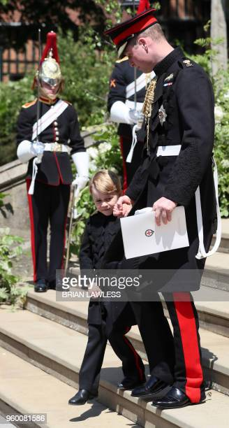 Prince Harry's brother and best man Prince William Duke of Cambridge and page boy Prince George of Cambridge leave after attending the wedding...