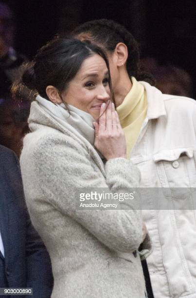 Prince Harry's fiance Meghan Markle gestures as she arrives Pop Brixton to see the broadcaster's work supporting young people through creative...