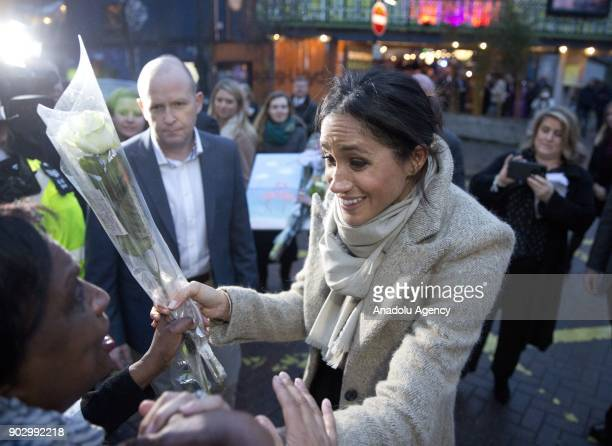 Prince Harry's fiance Meghan Markle greet the crowd as they arrive Pop Brixton to see the broadcaster's work supporting young people through creative...