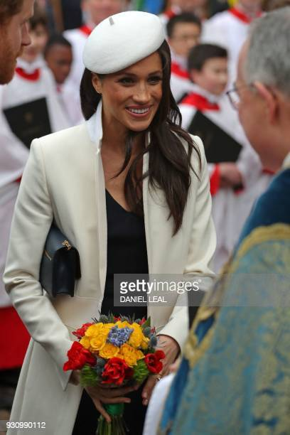Prince Harry's fiancee US actress Meghan Markle smiles after attending a Commonwealth Day Service at Westminster Abbey in central London on March 12...