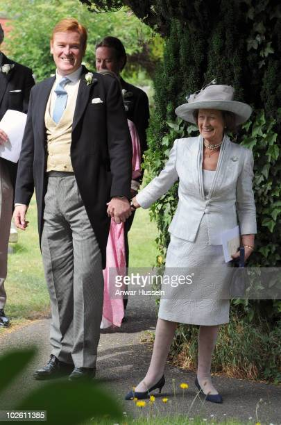 Prince Harry's former Equerry Mark Dyer and his mother arrive to his wedding to Amanda Kline from Texas at St Edmund's Church Crickhowell on July 3...