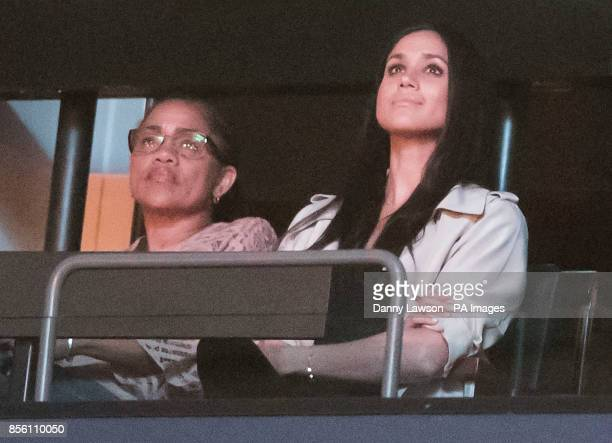 Prince Harry's girlfriend Meghan Markle is pictured with her mother Doria Ragland during the Invictus Games Closing Ceremony Air Canada Centre in...