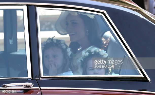 Prince Harry's niece and bridesmaid Princess Charlotte and Britain's Catherine Duchess of Cambridge arrive for the wedding ceremony of Britain's...