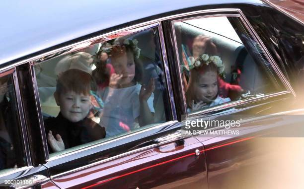 Prince Harry's niece and bridesmaid Princess Charlotte arrives for the wedding ceremony of Britain's Prince Harry Duke of Sussex and US actress...