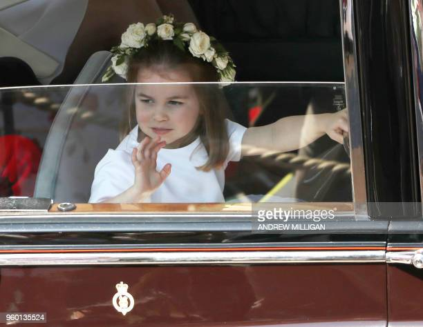 Prince Harry's niece and bridesmaid Princess Charlotte leave the wedding ceremony of Britain's Prince Harry Duke of Sussex and US actress Meghan...