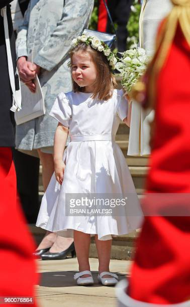 Prince Harry's niece and bridesmaid Princess Charlotte leaves after attending the wedding ceremony of Britain's Prince Harry Duke of Sussex and US...