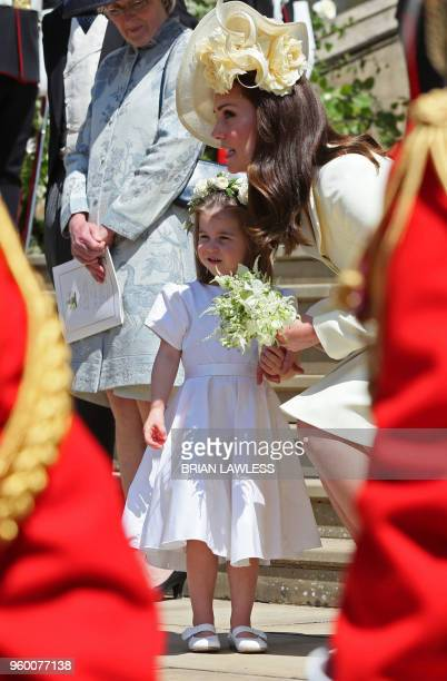 Prince Harry's niece and bridesmaid Princess Charlotte with her mother Britain's Catherine Duchess of Cambridge leaving after attending the wedding...